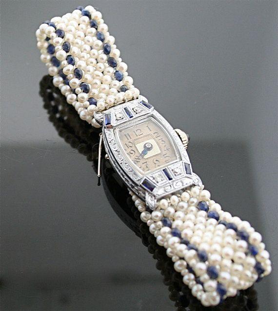mavi ve beyaz incili modern bayan saat tasarımı