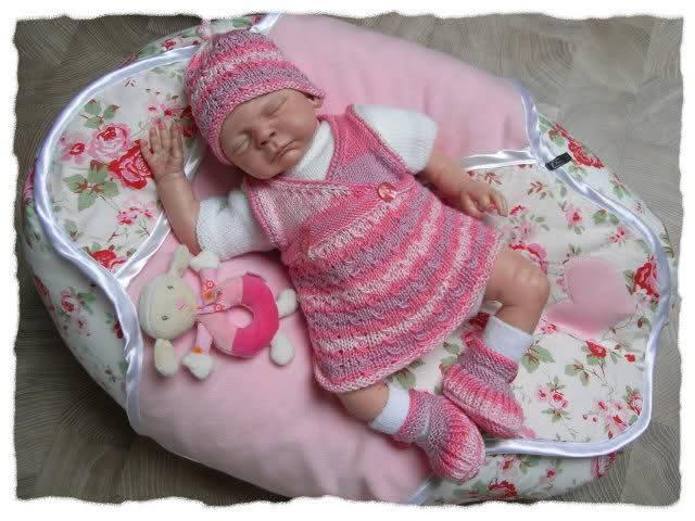 En güzel örgü bebek elbise takımları