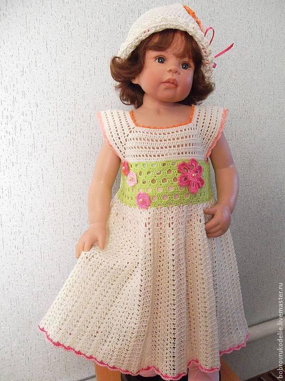 Beyaz ve çiçekli örgü kız çocuk elbise ve beresi